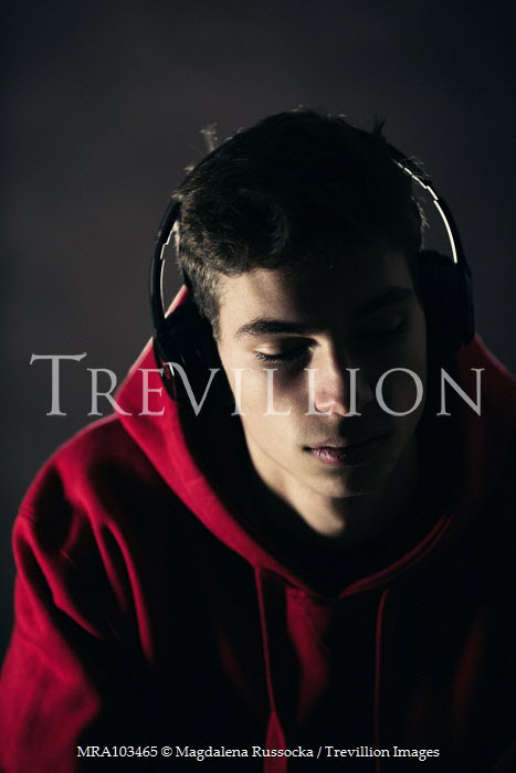 Magdalena Russocka teenage boy in red hoodie with headphones Men