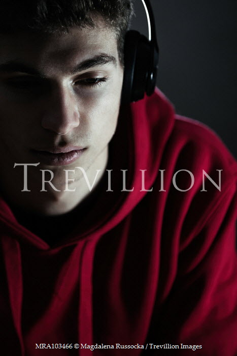 Magdalena Russocka teenage boy in red hoodie with headphones insiade