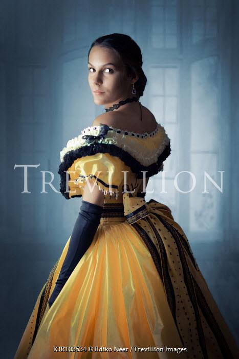 Ildiko Neer Victorian woman in yellow ball gown