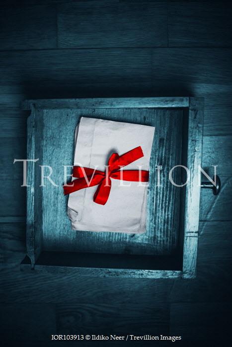 Ildiko Neer Envelops with red ribbon in drawer