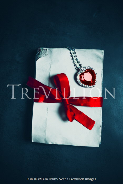 Ildiko Neer Envelops with red ribbon and heart pendant with red gem
