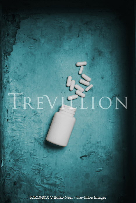 Ildiko Neer Medicine container with white pills