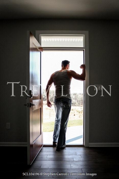 Stephen Carroll MAN STANDING IN DOORWAY WATCHING GARDEN Men