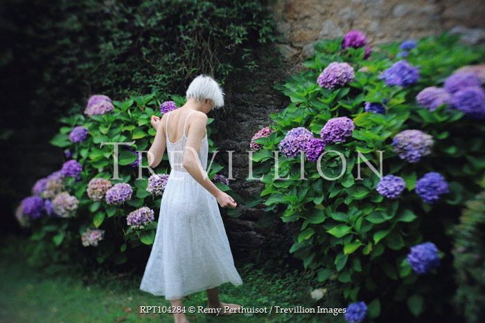 Remy Perthuisot BLONDE GIRL IN GARDEN IN WHITE DRESS Women