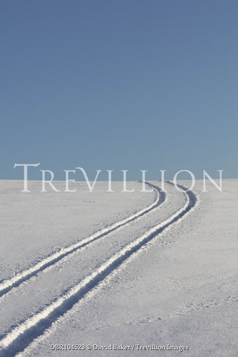 David Baker HILL WITH TRACKS IN SNOWY FIELD Snow/ Ice