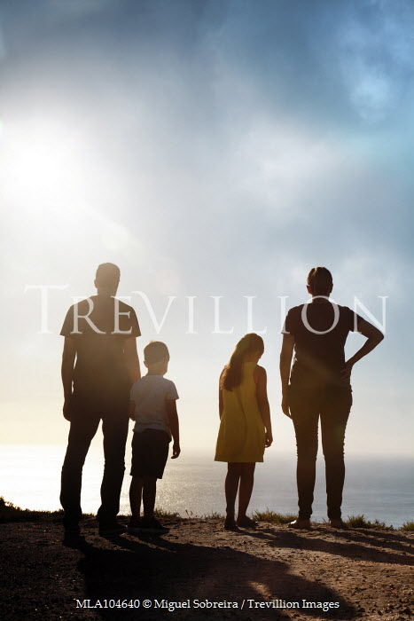 Miguel Sobreira Family Standing on Hill Over Sea Groups/Crowds