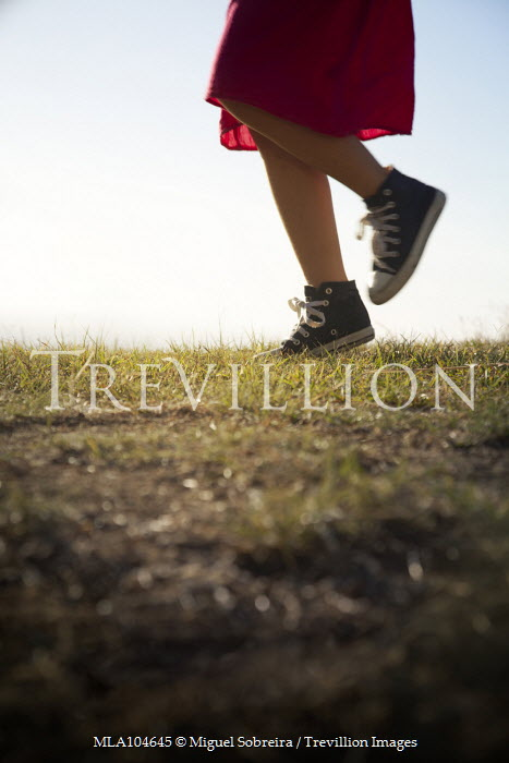 Miguel Sobreira Girl Walking on Hilltop in Boots Children