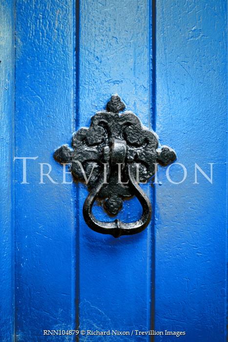Richard Nixon METAL KNOCKER ON BLUE DOOR Building Detail