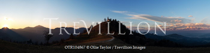 Ollie Taylor CHURCH ON HILL AT SUNSET Rocks/Mountains