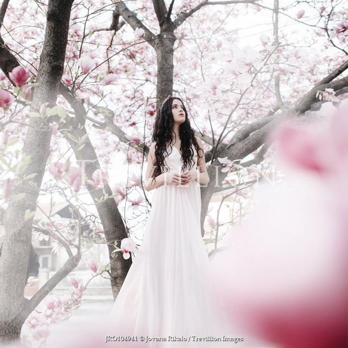Jovana Rikalo BRUNETTE GIRL STANDING BY MAGNOLIA TREES Women
