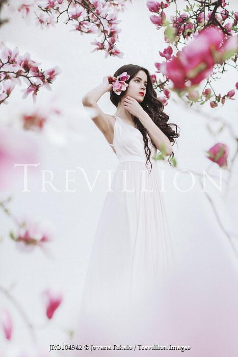 Jovana Rikalo BRUNETTE GIRL BY TREE WITH PINK FLOWERS Women