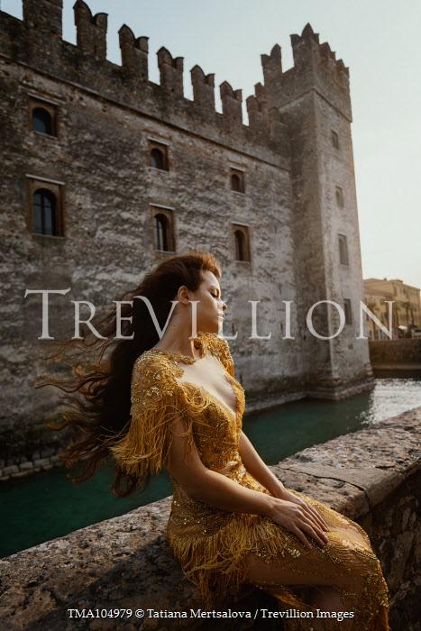 Tatiana Mertsalova GIRL IN GOLDEN DRESS SITTING BY CASTLE Women
