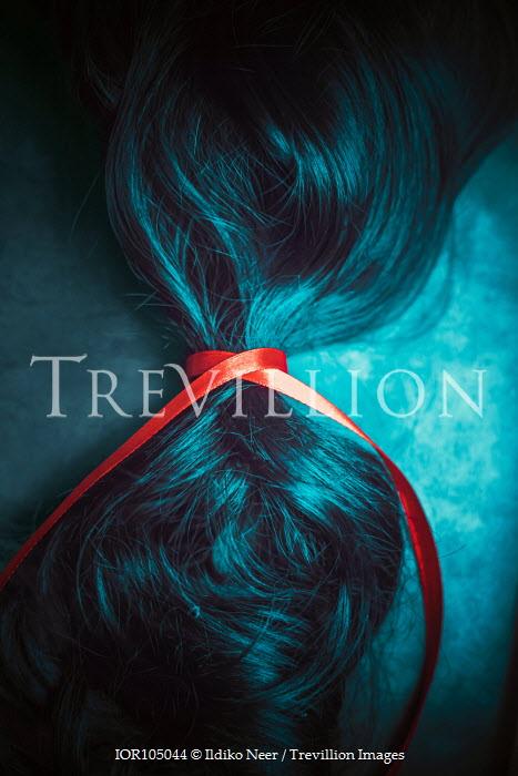 Ildiko Neer Red ribbon in black hair