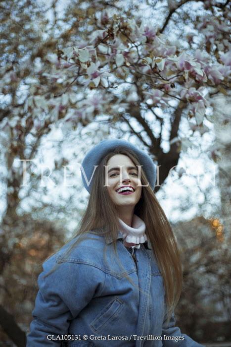 Greta Larosa SMILING BRUNETTE GIRL BY MAGNOLIA TREE Women