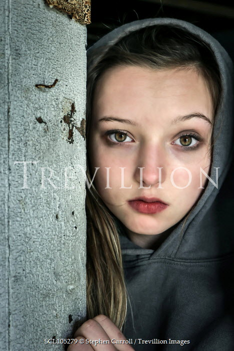 Stephen Carroll CLOSE UP OF SAD YOUNG GIRL BY DOOR Children