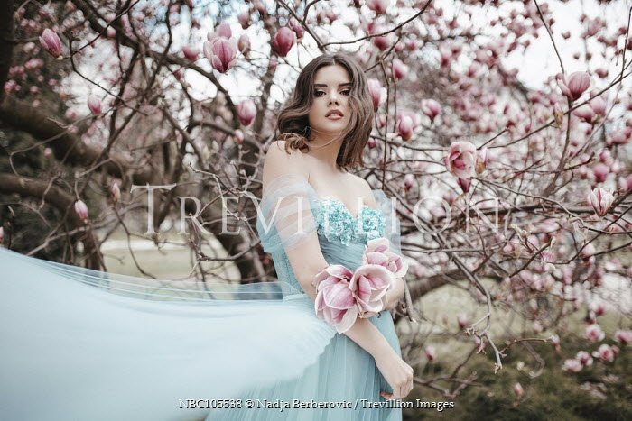 Nadja Berberovic WOMAN IN SILK DRESS BY MAGNOLIA TREE Women