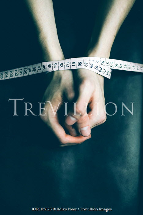 Ildiko Neer Male hand tied with tape measure