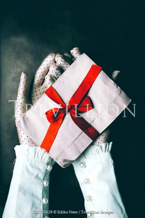 Ildiko Neer Woman holding letters in spotty gloves