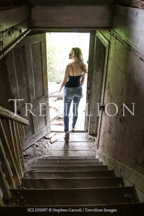 Stephen Carroll BLONDE WOMAN AT BOTTOM OF OLD STAIRCASE Women