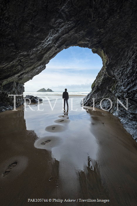 Philip Askew PERSON STANDING AT ENTRANCE OF SEA CAVE Men