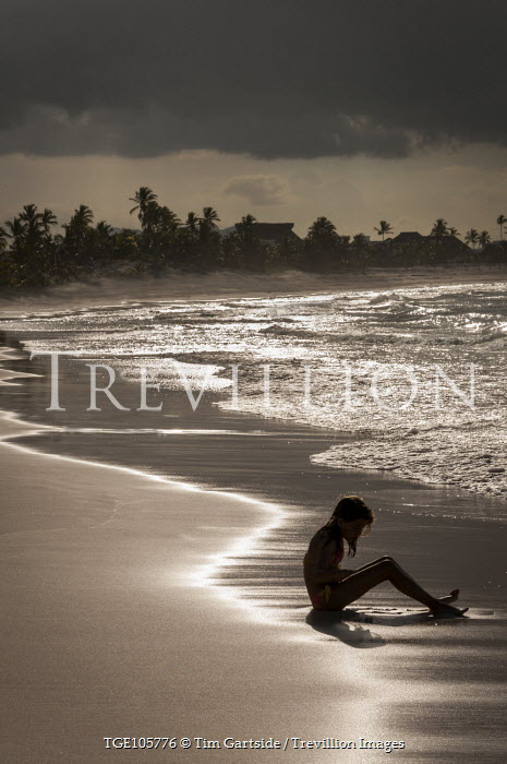 Tim Gartside YOUNG GIRL SITTING ON SANDY BEACH Children