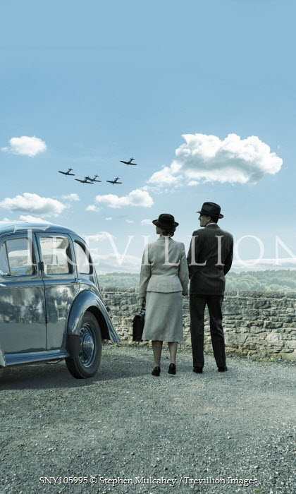 Stephen Mulcahey RETRO COUPLE BY CAR WATCHING PLANES Couples