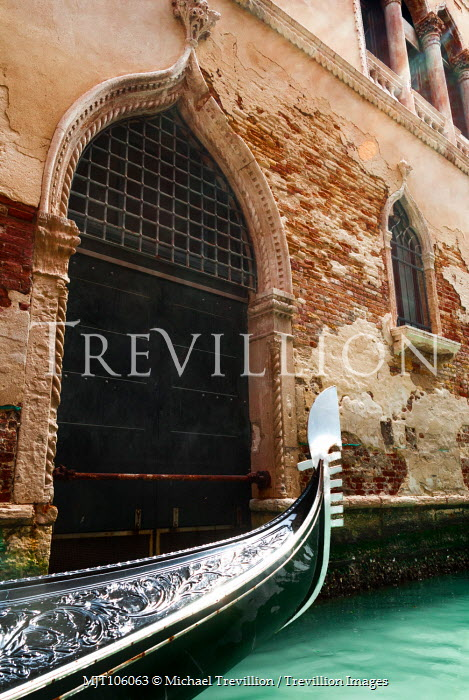 Michael Trevillion GONDOLA OUTSIDE DOORWAY OF OLD BUILDING Miscellaneous Cities/Towns