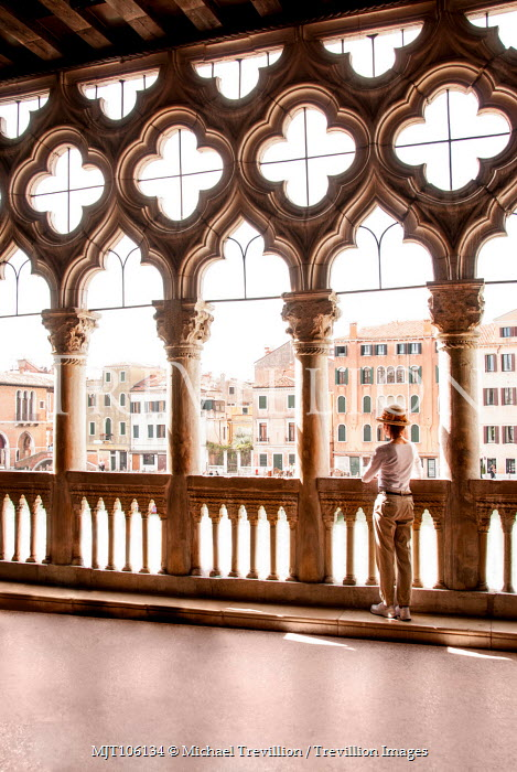 Michael Trevillion WOMAN IN GRAND VENETIAN BUILDING WATCHING CANAL Women
