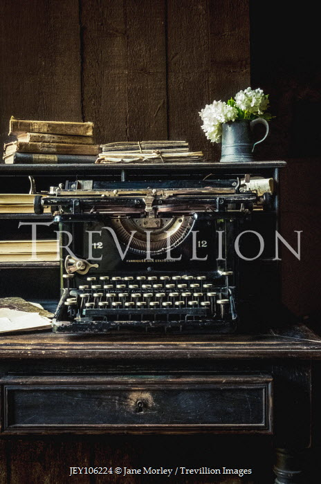 Jane Morley ANTIQUE TYPEWRITER ON DESK WITH BOOKS AND FLOWERS Interiors/Rooms