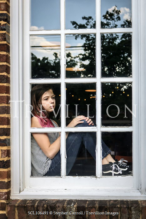 Stephen Carroll GIRL SITTING INDOORS BY WINDOW OF HOUSE Children