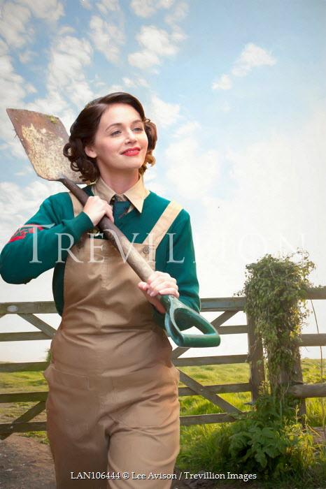 Lee Avison optimistic wartime land girl with spade