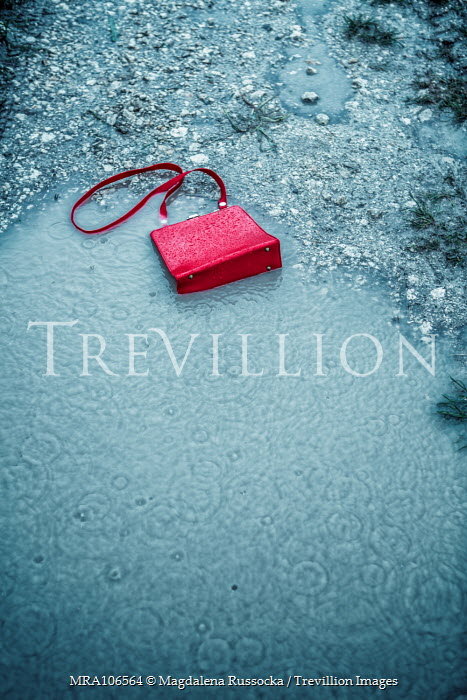 Magdalena Russocka red handbag abandoned in puddle Miscellaneous Objects