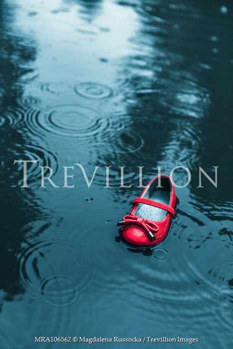Magdalena Russocka red child's shoe in water Miscellaneous Objects