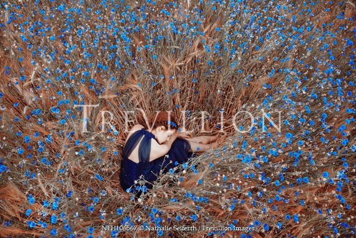 Nathalie Seiferth Women in field of blue flowers Women