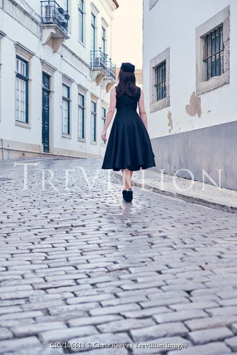 Chris Reeve Retro woman on cobbled street Women