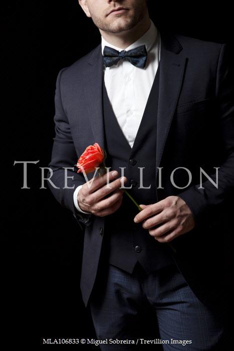 Miguel Sobreira Man in suit Holding Rose Men