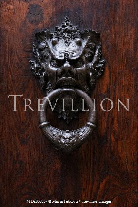 Maria Petkova metal knocker on wooden door Miscellaneous Buildings