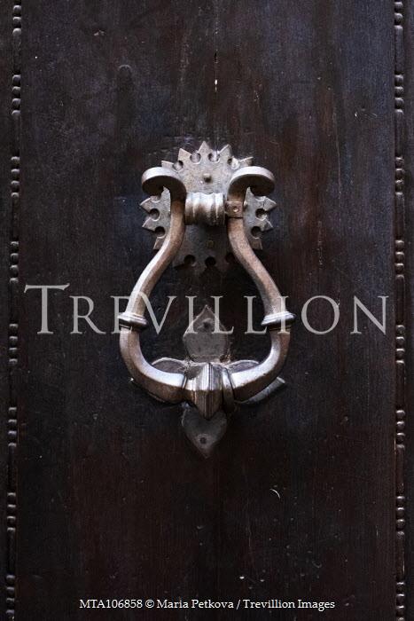 Maria Petkova metal knocker on wooden door Building Detail