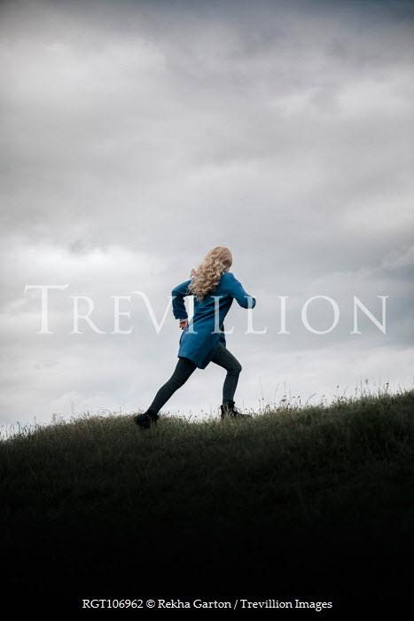Rekha Garton BLONDE WOMAN RUNNING IN FIELD Women