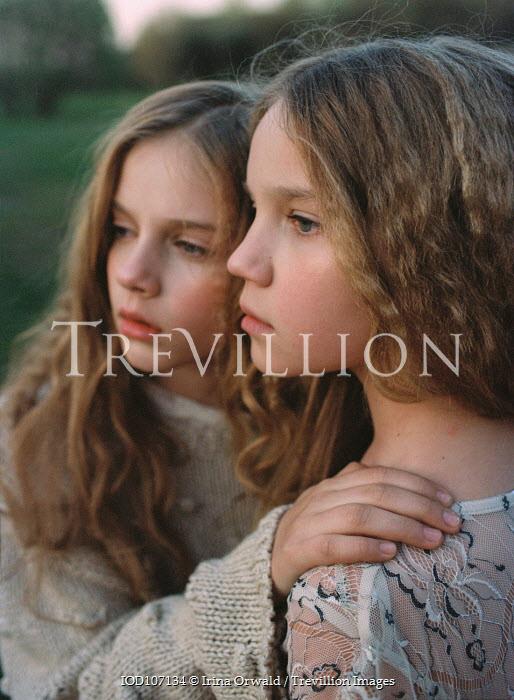 Irina Orwald Two girls looking into distance Children