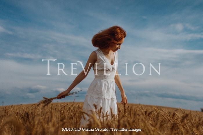Irina Orwald Girl walking in crop field Women