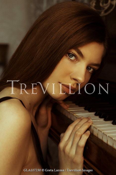 Greta Larosa CLOSE UP OF BRUNETTE WOMAN BY PIANO Women
