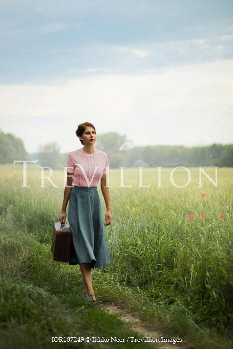 Ildiko Neer Vintage woman walking on field