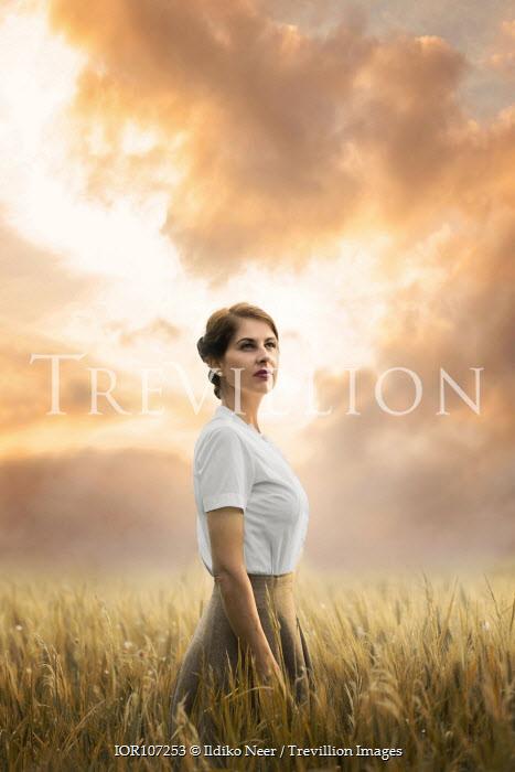 Ildiko Neer Vintage woman standing in wheat field
