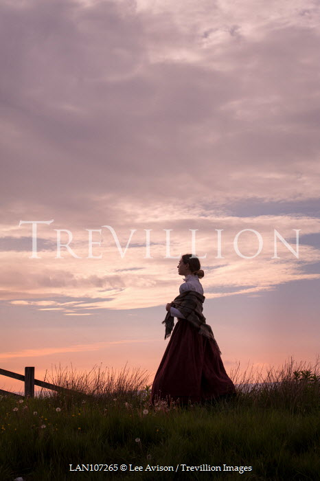 Lee Avison victorian woman silhouette against sunset