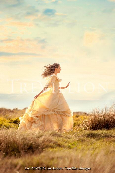Lee Avison beautiful victorian woman running on the moors