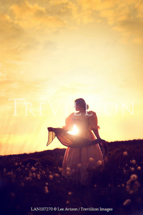 Lee Avison victorian woman at sunset in silhouette
