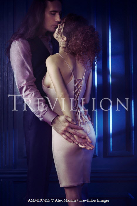 Alex Maxim MAN AND WOMAN EMBRACING INDOORS AT NIGHT Couples