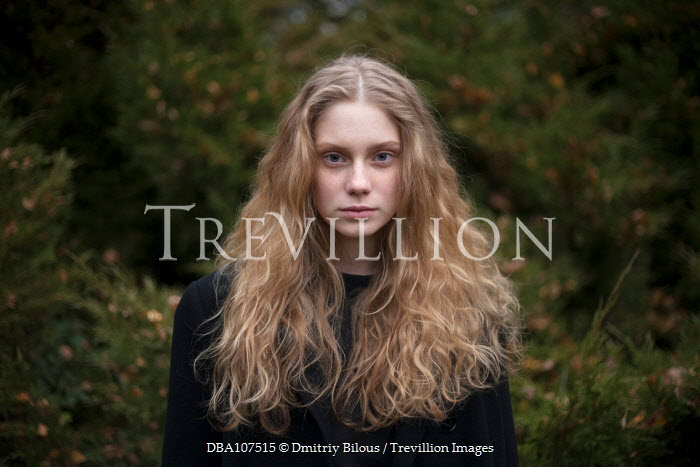 Dmitriy Bilous CLOSE UP OF SERIOUS BLONDE GIRL OUTDOORS Women