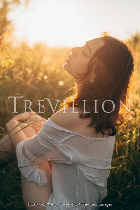 Ihor Ustynskyi DREAMY GIRL SITTING IN SUNLIT FIELD Women